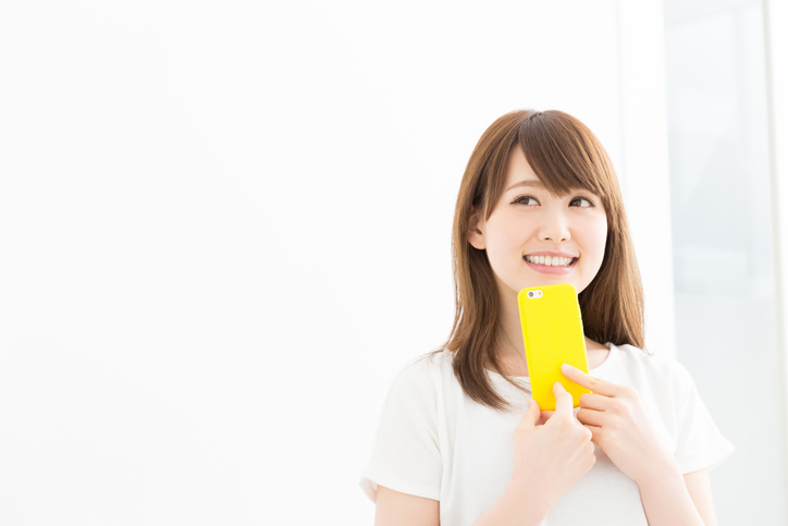 Japanese woman holding a smart phone