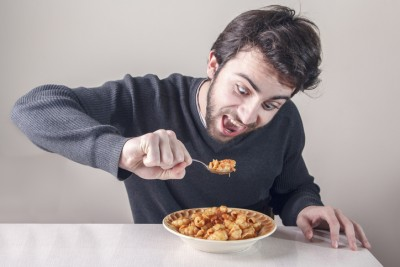 Hungry man eating food