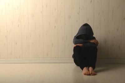 Suffering child in dark room
